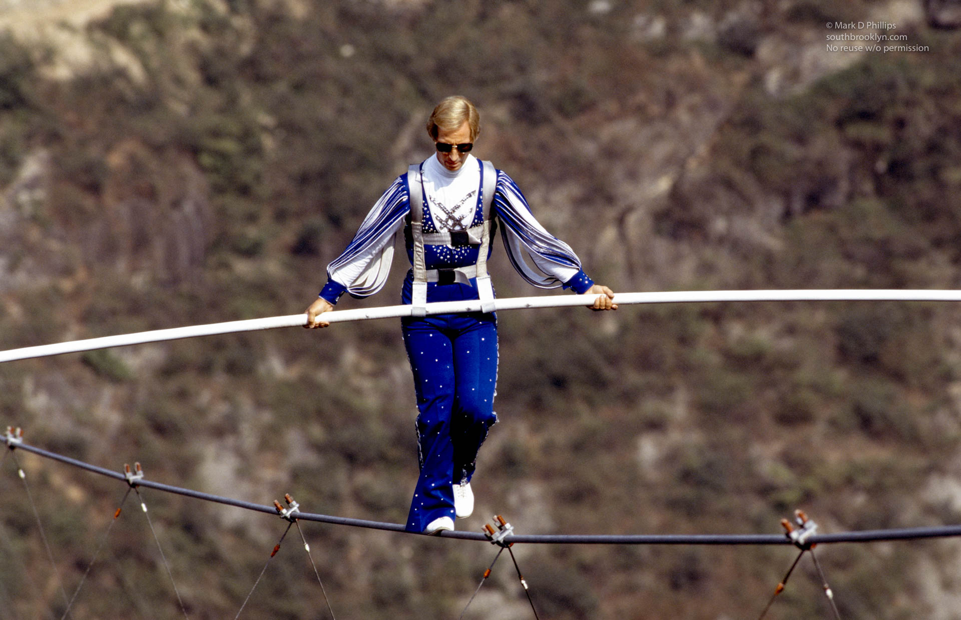 Jay Cochrane skywalks in the center of Qutang Gorge, China, during The Great China Skywalk on October 28, 1995. ©Mark D Phillips
