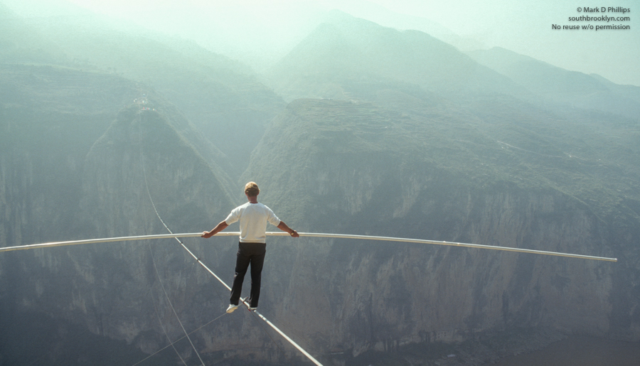 Jay Cochrane tests the wire the day before the Great China Skywalk in Qutang Gorge on October 27, 1995. ©Mark D Phillips