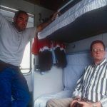 Steve Sless and Rik Paulsen in sleeper car train travelling from Beijing to the Great China Skywalk in Qutang Gorge, China