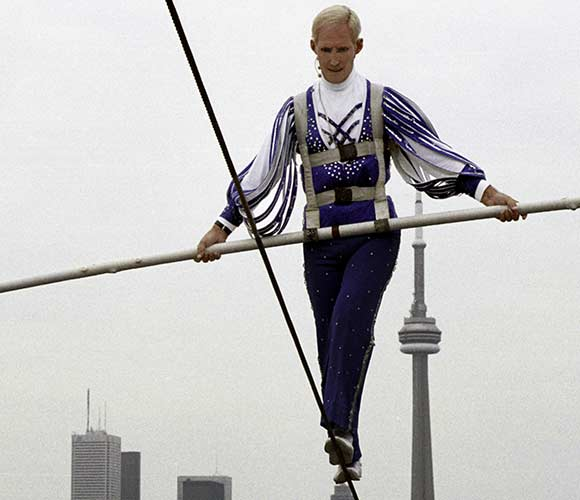 Jay Cochrane skywalks above the grounds of the Canadian National Exhibition (CNE) on 11 August. Cochrane, 59, will skywalk daily at the CNE for the 125th anniversary of the event. He last performed skywalks at the event for the 100th Anniversary. Photo by Mark D. Phillips