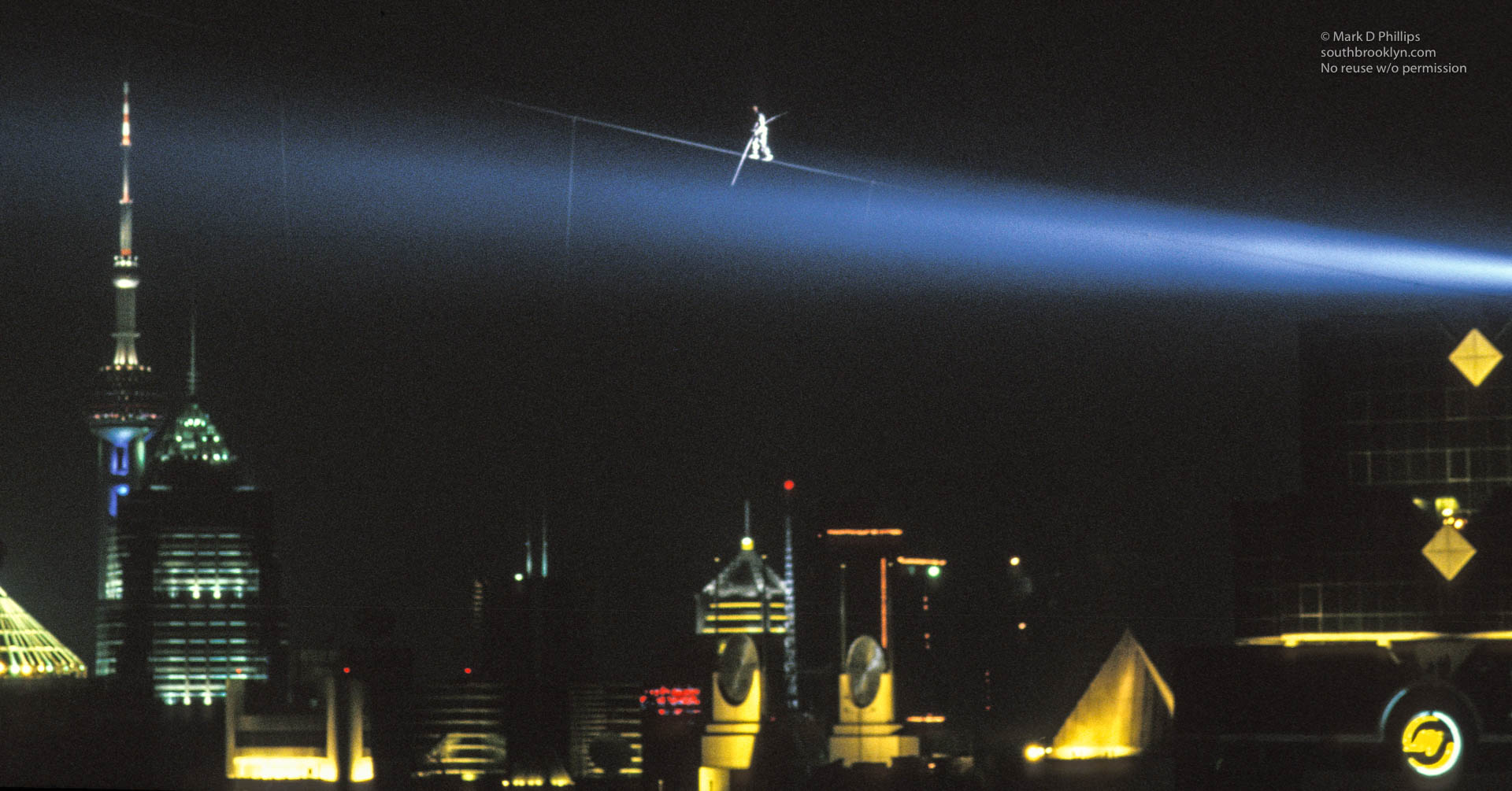 Canadian Jay Cochrane walks above the Pearl of the Orient Tower in Shanghai, China as he accomplished a world record for the highest and longest nighttime building-to-building wire walk on September 24, 1996 during the Shanghai Tourism Festival. ©Mark D Phillips