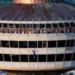 Jay Cochrane, skywalks in front of hundreds crammed into the observation deck of the Skylon Tower for the first day of Skywalk2012 on July 6, 2012. Jay completed his walk to the Hilton Fallsview Hotel, 1300 feet away in Niagara Falls, Canada. ©Mark D Phillips
