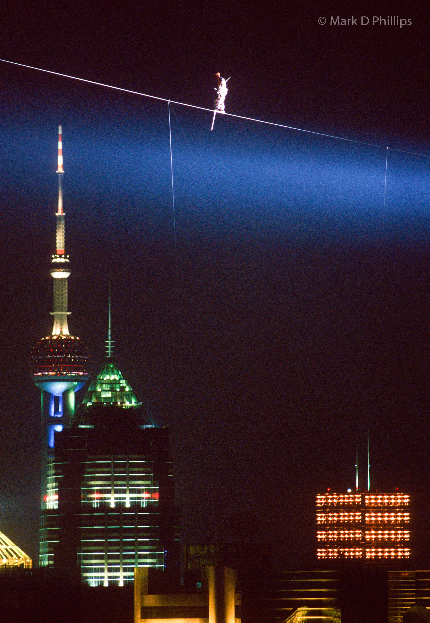 Jay Cochrane skywalks in Shanghai, China, for the opening night of the Shanghai Tourism Festival on September 24, 1996, passing above the Pearl of the Orient tower in the Pudong district. ©Mark D Phillips