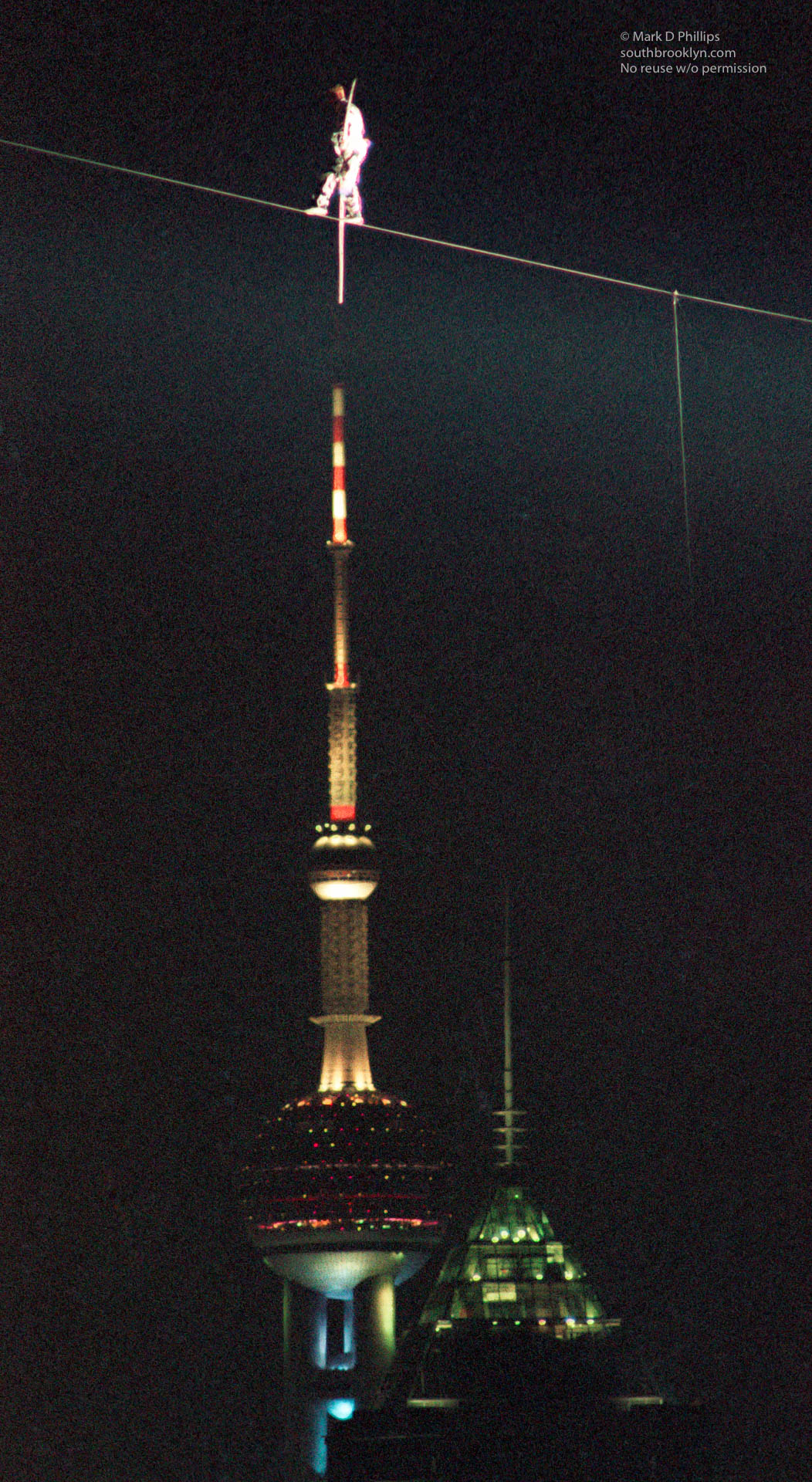Jay Cochrane skywalks in Shanghai, China, for the opening night of the Shanghai Tourism Festival on September 24, 1996, passing above the Pearl of the Orient tower in the Pudong district.