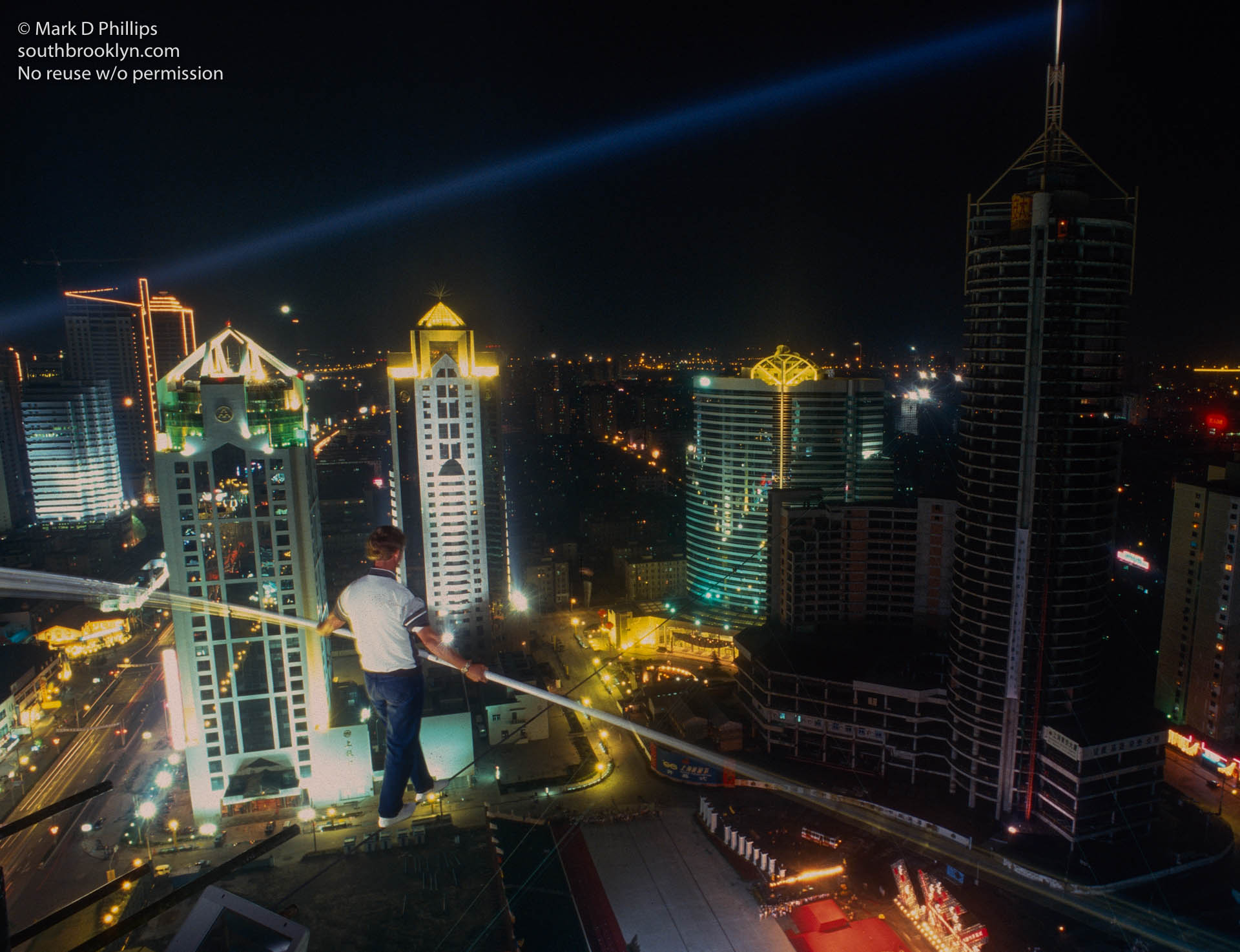 Jay Cochrane tests the wire  in Shanghai, China, the night before the opening of the Shanghai Tourism Festival on September 24, 1996