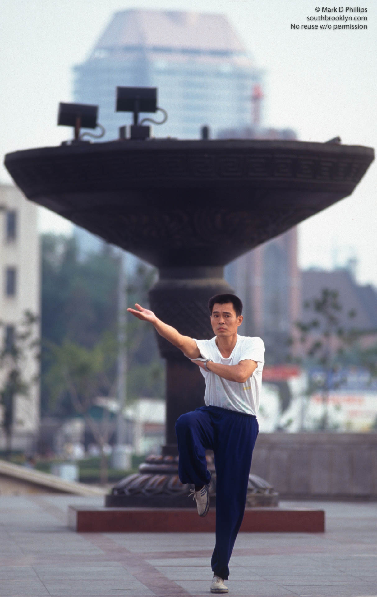 A Shanghai resident does Tai Che in a park in Shanghai, China, for the opening night of the Shanghai Tourism Festival on September 24, 1996.